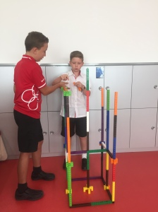 Luzius and Timon are working  on a tower structure, integrating place value as a Math project.