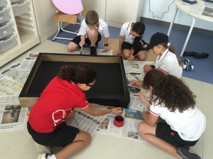 Grade 5: Working on designing our TV display box for 'Where we are in place and time'