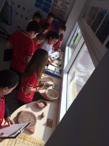 Grade 5 in the process of tuning into Unit 3 exploring Artifacts and guessing their use and where they were discovered.